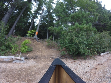 Looking up at the site from the canoe. You can see the slight hill you have to climb to get to the rest of the campsite.