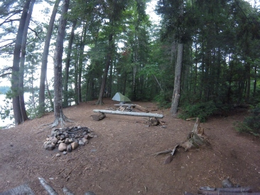 View of the fire pit area with tent in the background.