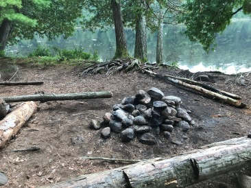 The fire pit and some log benches