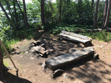 The fire pit area and benches