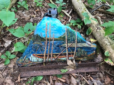 A rock painted with one of Tom's pictures.